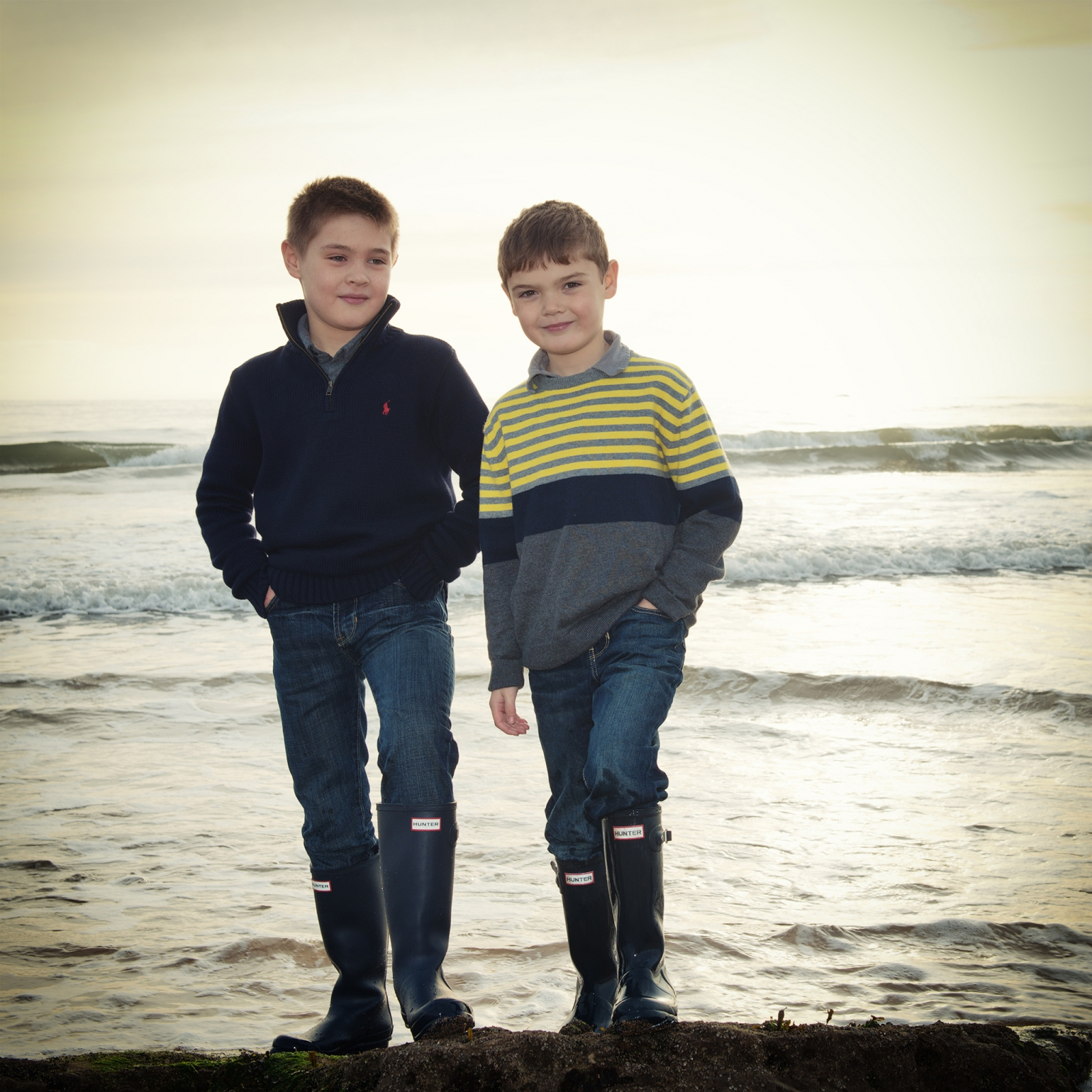 Lifestyle location portrait of boys on the beach, brothers