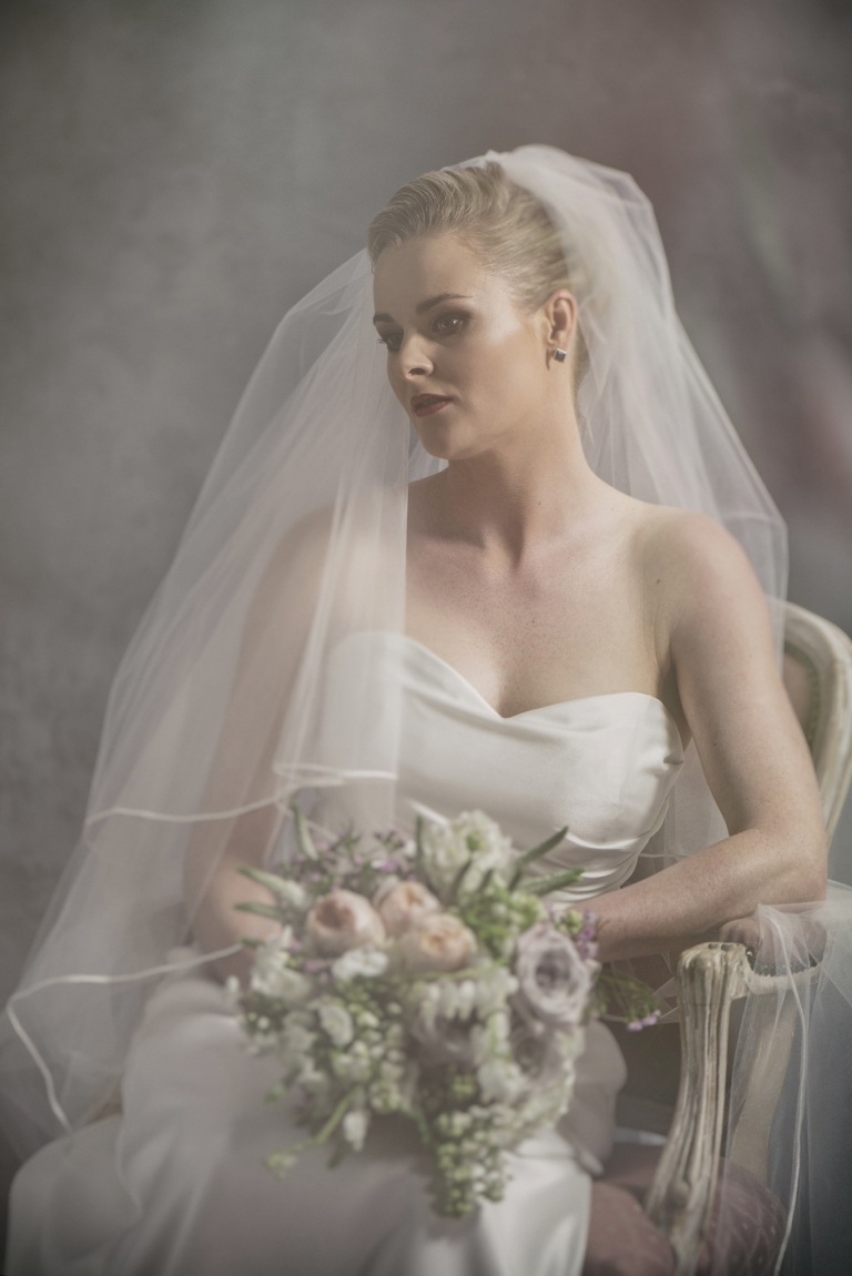 Fine art bridal portrait from 37 Degrees Studio bride seated with bouquet