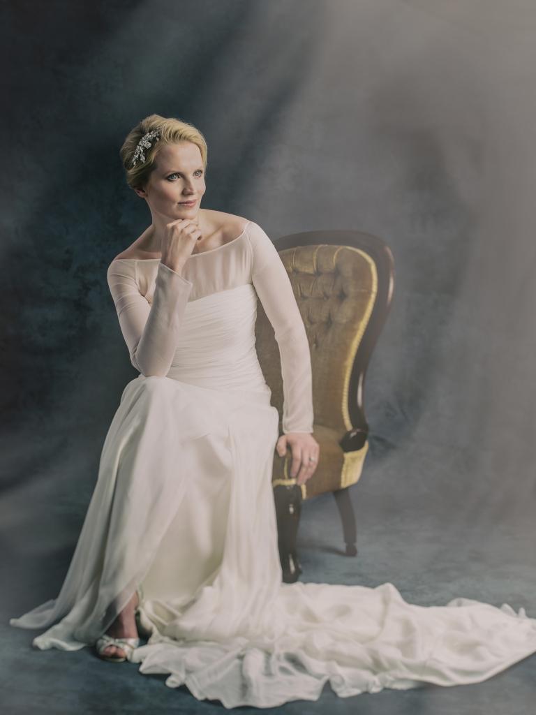 Fine art bridal portrait from 37 Degrees Studio seated bride