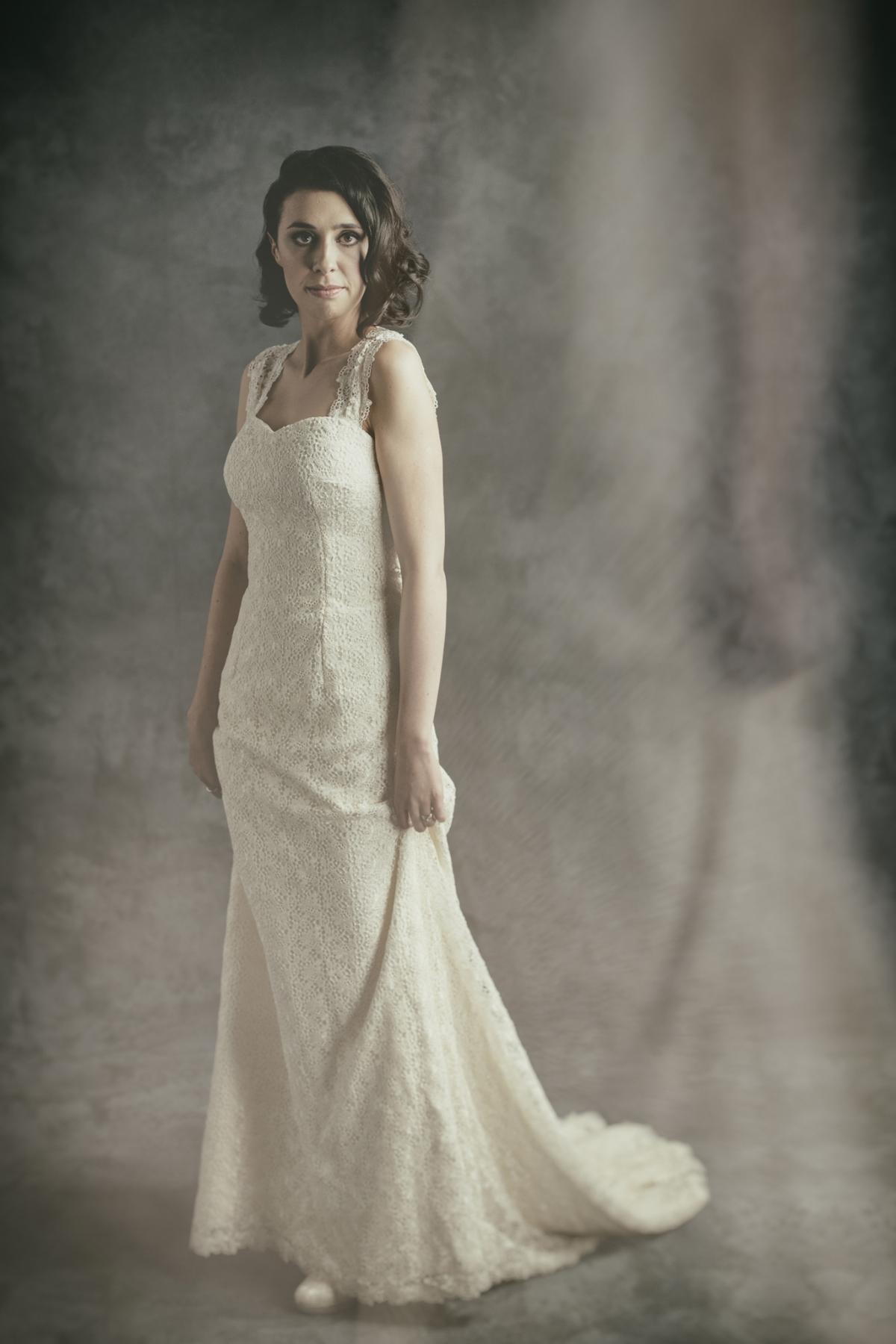 Fine art bridal portrait from 37 Degrees Studio full length bride holding dress