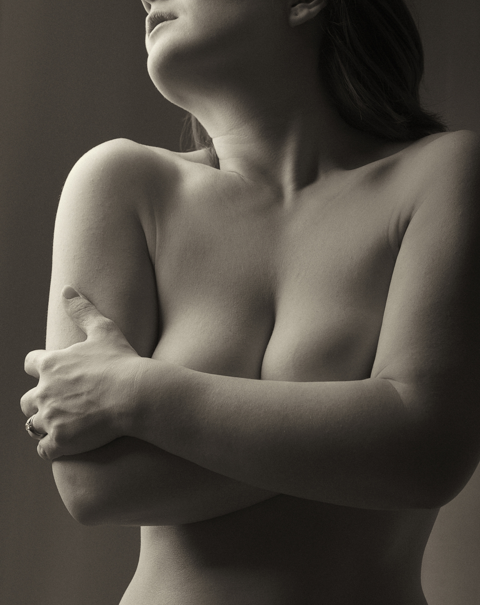 Fine art portrait of a female hugging herself